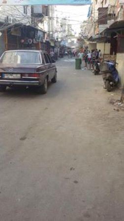بالصور : اعادة فتح الطريق في الشارع التحتاني لمخيم عين الحلوة