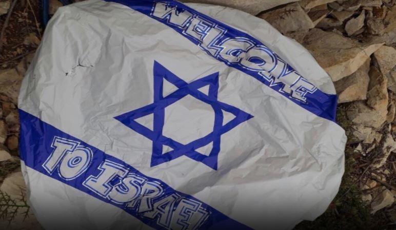 بالصورة - العثور على منطاد عليه علم اسرائيل في خراج مزيارة زغرتا
