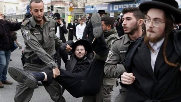 اشتباكات بين الحريديم والشرطة الإسرائيلية رفضا للتجنيد