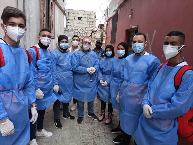 جولة جديدة لفريق مكافحة الكورونا التابع لمستشفى الشهيد محمود الهمشري  في مخيم عين الحلوة