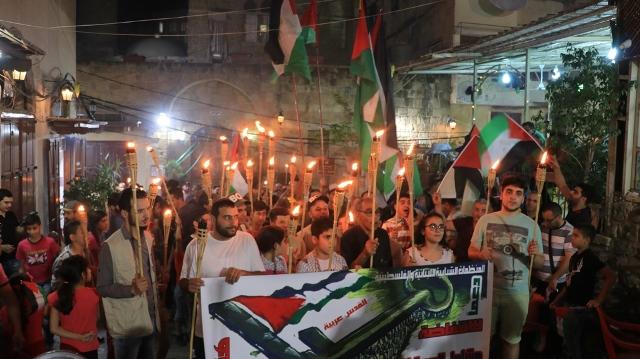 بالصور... مسيرة مشاعل في صيدا تضامناً مع كفاح الشعب الفلسطيني في الأرض المحتلة